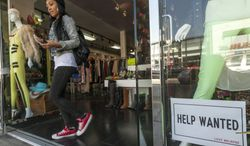 """**FILE** A """"help wanted"""" sign is posted on the front window of a clothing boutique in Los Angeles on Dec. 7, 2012. (Associated Press)"""