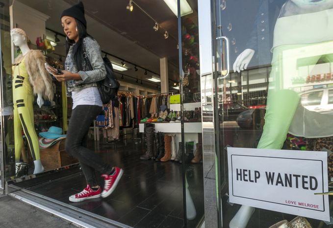 "**FILE** A ""help wanted"" sign is posted on the front window of a clothing boutique in Los Angeles on Dec. 7, 2012. (Associated Press)"