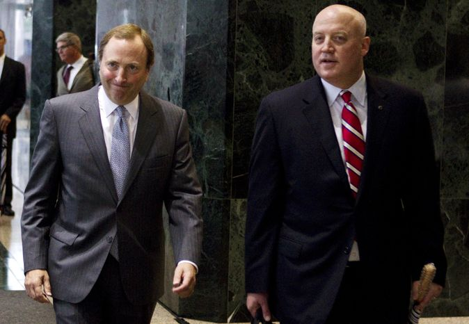 **FILE** NHL Commissioner Gary Bettman (right) and deputy commissioner Bill Daly speak Dec. 6, 2012, to reporters in New York. (Associated Press)