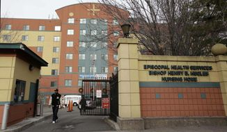 ** FILE ** This file photo of Dec. 24, 2012, shows the Bishop Henry B. Hucles Episcopal Rehabilitation and Skilled Nursing Center in New York. (AP Photo/Kathy Willens, File)
