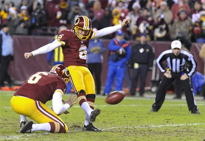Redskins place kicker Kai Forbath (2) kicks an extra point in the second quarter to tie the Cowboys 7-7 during their NFL football game Sunday, Dec. 30, 2012, in Landover, Md. Redskins defeated the Cowboys 28-18, securing a playoff berth. (AP Photo/Richard Lipski)