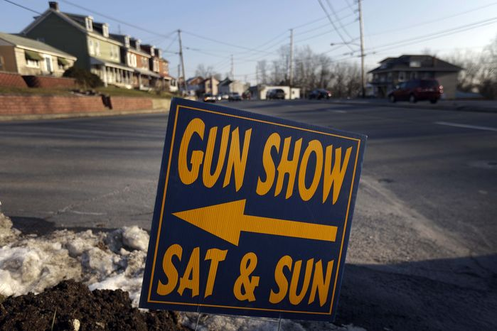 ** FILE ** A sign is posted for an upcoming gun show, Friday, Jan. 4, 2013, in Leesport, Pa. (AP Photo/Matt Rourke)