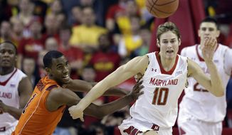 Virginia Tech guard Robert Brown, left, and Maryland guard/forward Jake Layman chase after a loose ball during the second half of an NCAA college basketball game in College Park, Md., Saturday, Jan. 5, 2013. Maryland won 94-71. (AP Photo/Patrick Semansky)