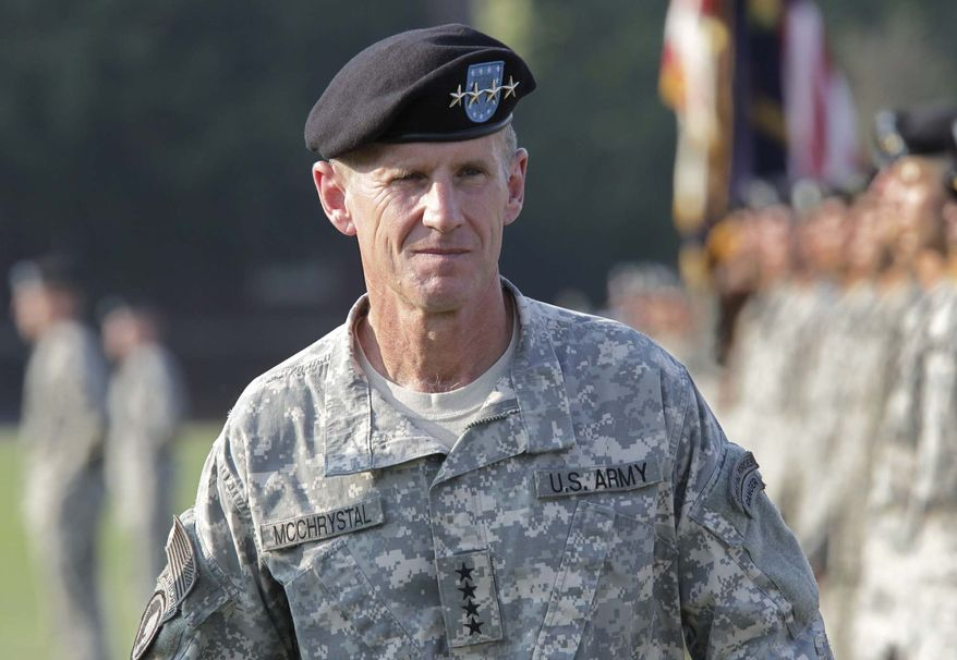 ** FILE ** This July 23, 2010, file photo shows Gen. Stanley McChrystal reviewing troops for the last time as he is honored at a retirement ceremony at Fort McNair in Washington. (AP Photo/J. Scott Applewhite, file)