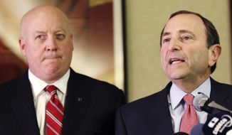 ** FILE ** In this Dec. 6, 2012, file photo, NHL Commissioner Gary Bettman, right, and deputy commissioner Bill Daly speak to reporters in New York. (AP Photo/Mary Altaffer, File)