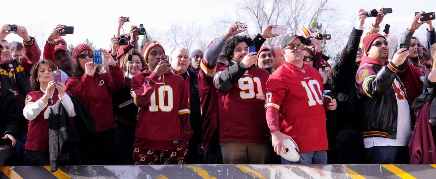 PReston keres/special to the washington times  Fans stand outside the stadium as Redskins players arrive for the game. Their high hopes for postseason glory were dashed.