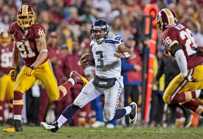 Seattle Seahawks quarterback Russell Wilson (3) runs for a first down in the second half against the Washington Redskins in the NFC wild card game at FedEx Field, Landover, Md., Sunday, January 6, 2013. (Craig Bisacre/The Washington Times)