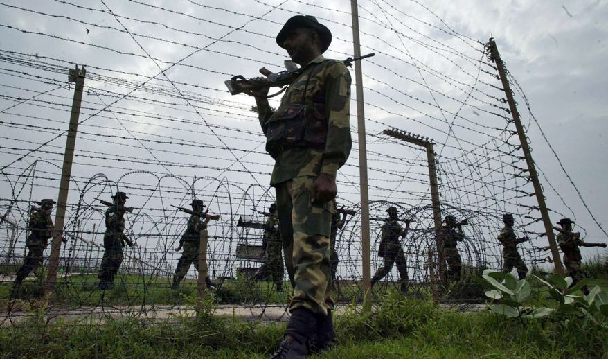 ** FILE ** Border Security Force soldiers patrol the India-Pakistan border at Kanachak, about 9 miles west of Jammu, India, in 2006. (AP Photo/Channi Anand)