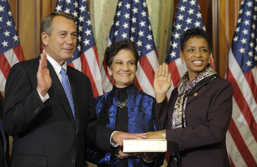 House Speaker John A. Boehner of Ohio, left, performs a mock swearing in for Rep. Donna Edwards, Maryland Democrat, Thursday, Jan. 3, 2013, on Capitol Hill in Washington as the 113th Congress began. (AP Photo/Cliff Owen)