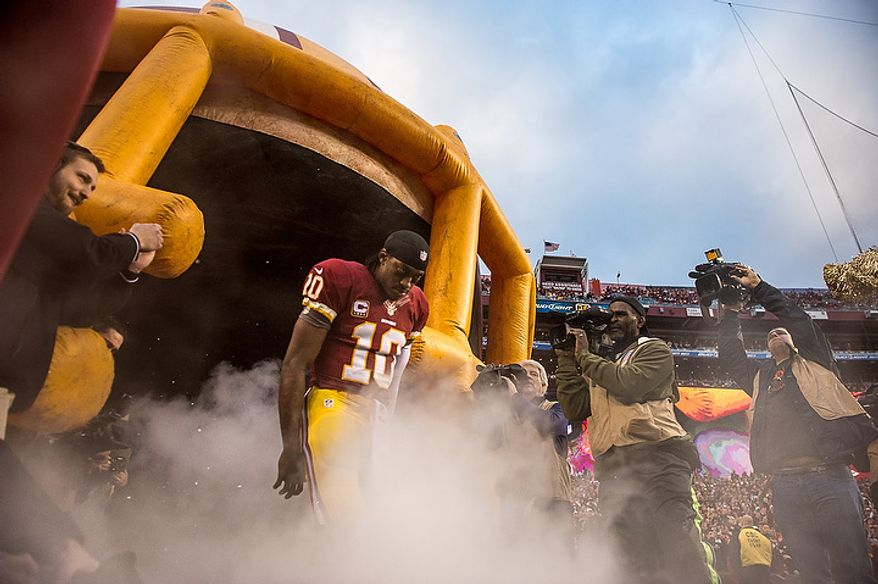 Washington Redskins quarterback Robert Griffin III (10) takes the field before the Washington Redskins play the Seattle Seahawks during the NFC wild card game at FedEx Field, Landover, Md., Sunday, January 6, 2013. (Andrew Harnik/The Washington Times)