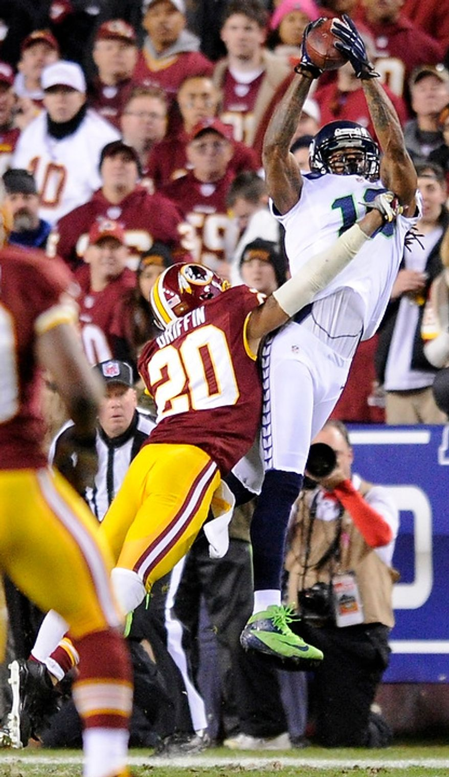 Seattle Seahawks wide receiver Sidney Rice (18) hauls in a first down reception over Washington Redskins strong safety Cedric Griffin (20) in the second quarter of the NFC wild card game at FedEx Field, Landover, Md., Jan. 6, 2013. (Preston Keres/Special to The Washington Times)
