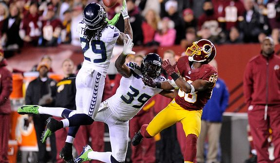Seattle Seahawks free safety Earl Thomas (29) intercepts a pass intended for Washington Redskins wide receiver Pierre Garcon (88) during second quarter action of the NFC wild card game at FedEx Field, Landover, Md., Jan. 6, 2013. (Preston Keres/Special to The Washington Times)