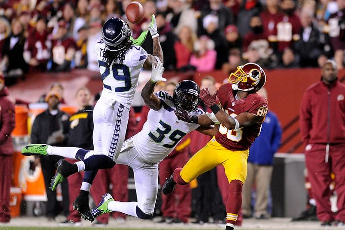 Seattle Seahawks free safety Earl Thomas (29) intercepts a pass intended for Washington Redskins wide receiver Pierre Garcon (88) during second quarter action of the NFC wild card game at F