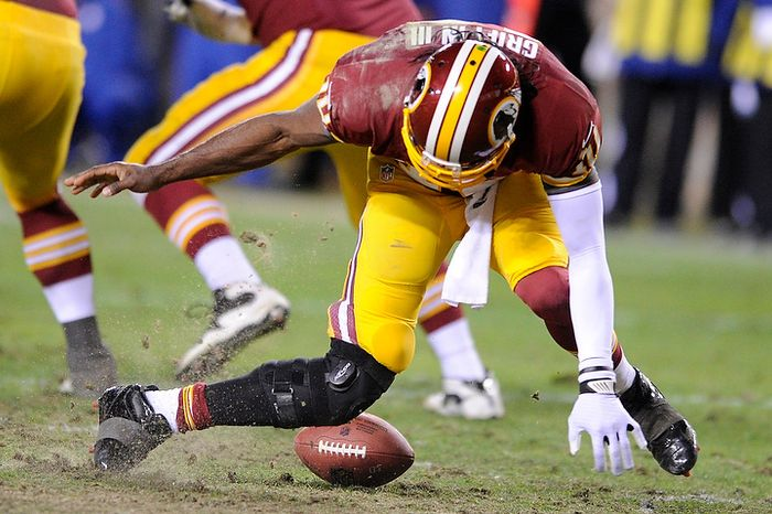 Washington Redskins quarterback Robert Griffin III (10) tries to pick up a fumbled snap in the fourth quarter and injures his leg in the NFC wild card game at FedEx Field, Landover, Md., Jan. 6, 2013. (Preston Keres/Special to The Washington Times)