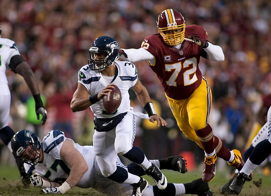 Washington Redskins defensive end Stephen Bowen (72) drives for Seattle Seahawks quarterback Russell Wilson (3) in the first half of the NFC wild card game at FedEx Field, Landover, Md., Sunday, January 6, 2013. (Craig Bisacre/The Washington Times)
