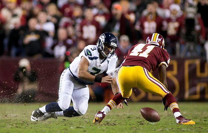 Washington Redskins free safety Madieu Williams (41) dives for the loose ball against Seattle Seahawks quarterback Russell Wilson (3) who fumbled in the second half of the NFC wild card game at FedEx Field, Landover, Md., Sunday, January 6, 2013. (Craig Bisacre/The Washington Times)