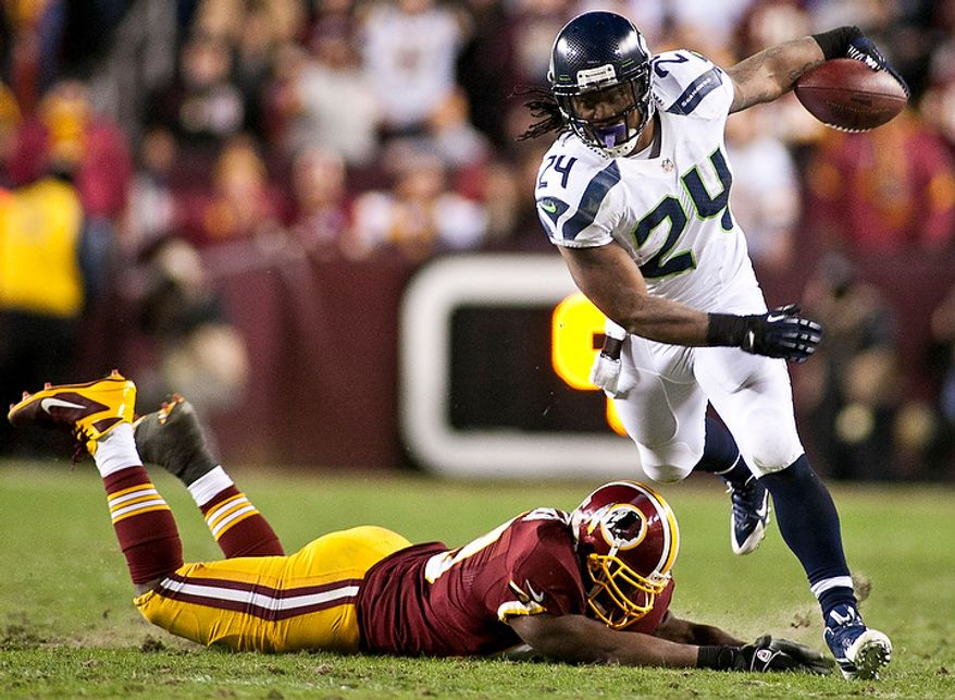 Washington Redskins strong safety Cedric Griffin (20) dives for Seattle Seahawks running back Marshawn Lynch (24) in the second half of the NFC wild card game at FedEx Field, Landover, Md., Sunday, January 6, 2013. (Craig Bisacre/The Washington Times)