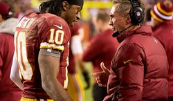 Washington Redskins quarterback Robert Griffin III (10) talks to Washington Redskins head coach Mike Shanahan in the second quarter as the Washington Redskins play the Seattle Seahawks during the NFC wild card game at FedEx Field, Landover, Md., Sunday, January 6, 2013. (Andrew Harnik/The Washington Times)