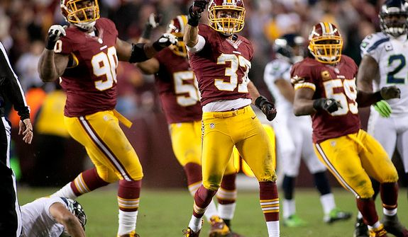 Washington Redskins strong safety Reed Doughty (37) celebrates after sacking Seattle Seahawks quarterback Russell Wilson (3) in the NFC wild card game at FedEx Field, Landover, Md., Sunday, January 6, 2013. (Craig Bisacre/The Washington Times)