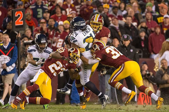 Seattle Seahawks running back Marshawn Lynch (24) charges ahead for an 18 yard gain in the fourth quarter as the Washington Redskins play the Seattle Seahawks during the NFC wild card game at FedEx Field, Landover, Md., Sunday, January 6, 2013. (Andrew Harnik/The Washington Times)