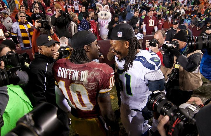 Washington Redskins quarterback Robert Griffin III (10) congratulates Seattle Seahawks defensive end Bruce Irvin (51) after losing 24 to 14 in the NFC wild card game at FedEx Field, Landover, Md., Sunday, January 6, 2013. (Craig Bisacre/The Washington Times)