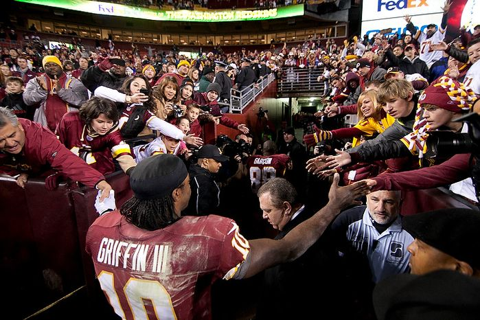 Washington Redskins quarterback Robert Griffin III (10) leaves the field after losing 24 to 14 against the Seattle Seahawks in the NFC wild card game at FedEx Field, Landov