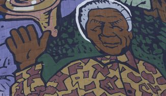 A giant portrait of former South African President Nelson Mandela adorns a cooling tower of a now-defunct power station in Soweto, South Africa, on Monday, Dec 31, 2012. Mr. Mandela is recovering at his Johannesburg home since being hospitalized for a lung infection and undergoing gallstone surgery. (AP Photo/Denis Farrell)