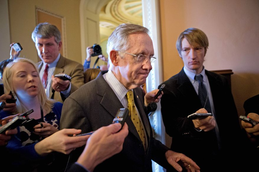 Senate Majority Leader Harry Reid (center) and his Republican counterpart are expected to negotiate on majority Democrats' attempts to weaken the filibuster rules before the Senate returns to work after the presidential inauguration. (Associated Press)