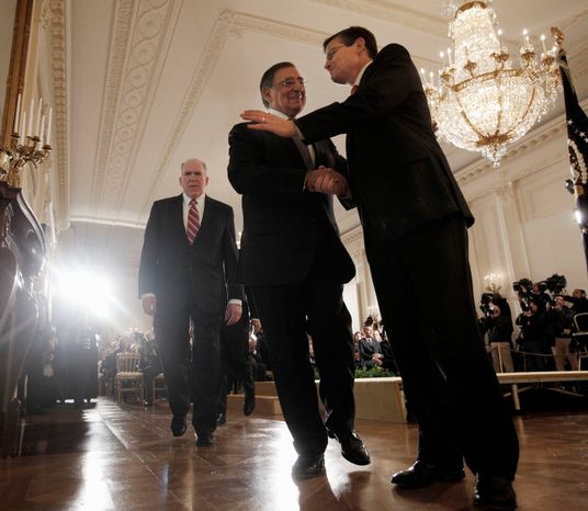 Outgoing Defense Secretary Leon E. Panetta (center) greets acting CIA Director Michael J. Morell after attending a news conference at the White House on Monday, at which President Obama announced that he is nominating his deputy national security adviser for homeland security and counterterrorism and John O. Brennan (left) as the CIA chief. (Associated Press)