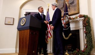 President Obama shakes hands with Sen. John F. Kerry, Massachusetts Democrat, the president's choice to be the next secretary of state, as he makes the announcement at the White House on Friday, Dec. 21, 2012. If Mr. Kerry is confirmed by his fellow senators, a special election will be held to fill his Senate seat. (Associated Press)