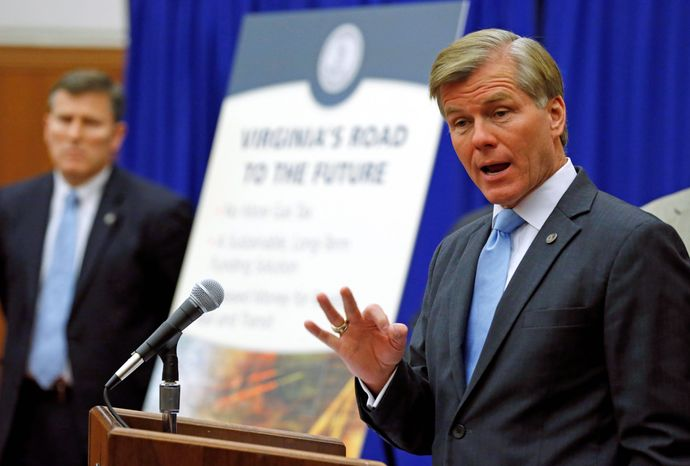 **FILE** Virginia Gov. Bob McDonnell gestures as he talks Jan. 8, 2012, about eliminating the state gasoline tax in return for an increase in the state sales tax to fund transportation needs. At left is Virginia Secretary of Transportation Sean T. Connaughton. (Associated Press)