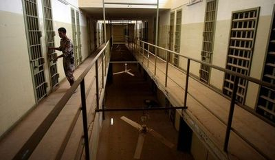 **FILE** An Iraqi army soldier closes the door of a cell in Abu Ghraib prison on the outskirts of Baghdad on Sept. 2, 2006, after the Iraqi government took over control from U.S. forces. (Associated Press)