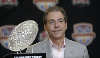 Alabama head coach Nick Saban poses with The Coaches' Trophy during a BCS National Championship college football game news conference Tuesday, Jan. 8, 2013, in Ft. Lauderdale, Fla. Alabama defeated Notre Dame 42-14 Monday night to win the national championship. (AP Photo/Morry Gash)