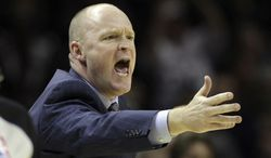 FILE - Milwaukee Buck head coach Scott Skiles argues a call during the fourth quarter of an NBA basketball game against the San Antonio Spurs, in this Dec. 5, 2012 file photo taken in San Antonio. Skiles and the Milwaukee Bucks have allegedly decided to part ways after just over four seasons together, ending a working relationship that seemed to been teetering on the brink for quite some time according to a person with knowledge of the move. (AP Photo/Eric Gay)