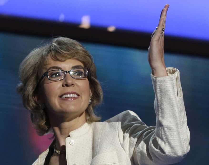 ** FILE ** In this Sept. 6, 2012, file photo, former Arizona Rep. Gabrielle Giffords blows a kiss after reciting the Pledge of Allegiance at the Democratic National Convention in Charlotte, N.C. (AP Photo/Charles Dharapak, File)