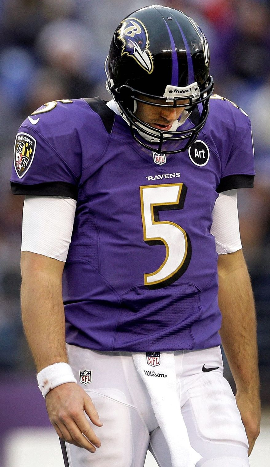 Ravens quarterback Joe Flacco walks off the field with his head down during the second half of Baltimore's 34-17 loss to Denver on Dec. 16. The two teams meet again Saturday in the divisional round of the playoffs. (Associated Press)