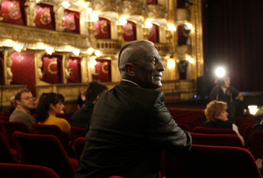 "Classical music composer and presidential candidate Vladimir Franz smiles prior to a rehearsal of his opera ""War with the Newts"" at the State Opera in Prague, Czech Republic, Tuesday, Jan. 8, 2013. Franz is one of nine candidates running for President in the first round of the Czech Republic Presidential election on Jan. 11-12, 2013. (AP Photo/Petr David Josek)"