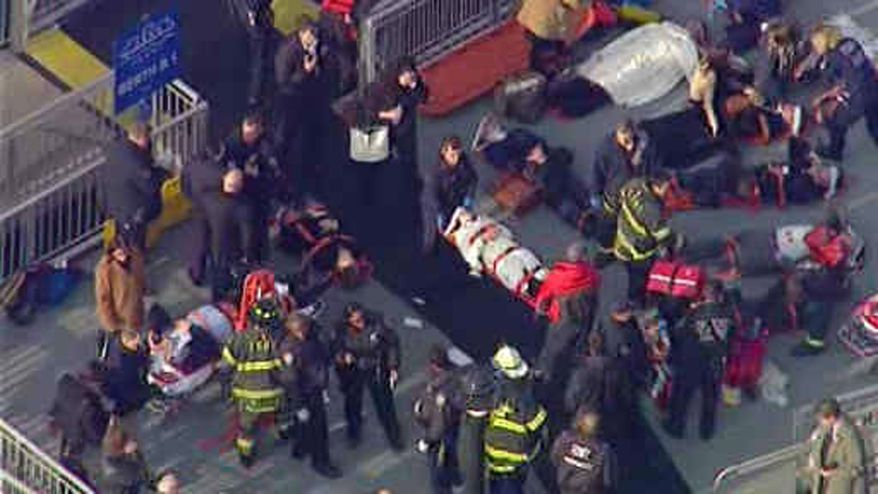 This aerial photo provided by WABC News Channel 7 shows emergency personnel at the scene of a ferry crash in Lower Manhattan, Wednesday, Jan. 9, 2013, in New York. The Fire Department says about 17 people were injured when a ferry from New Jersey struck a dock during rush hour. (AP Photo/WABC News Channel 7)