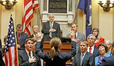 At the opening of the 2013 Virginia General Assembly on Wednesday, the Richmond Symphony Chorus sings the national anthem. (Associated Press)