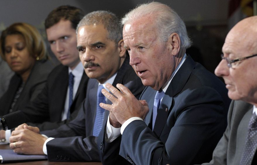 Vice President Joseph R. Biden, with Attorney General Eric H. Holder Jr. (left), speaks during a meeting with victims groups and gun-safety organizations in the Eisenhower Executive Office Building on the White House complex in Washington on Wednesday, Jan. 9, 2013. (AP Photo/Susan Walsh)