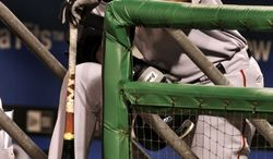 **FILE** San Francisco Giants' Barry Bonds waits on the dugout steps to bat in the eighth inning with the bases loaded against the Pittsburgh Pirates during a baseball game in Pittsburgh on July 28, 2006. (Associated Press)