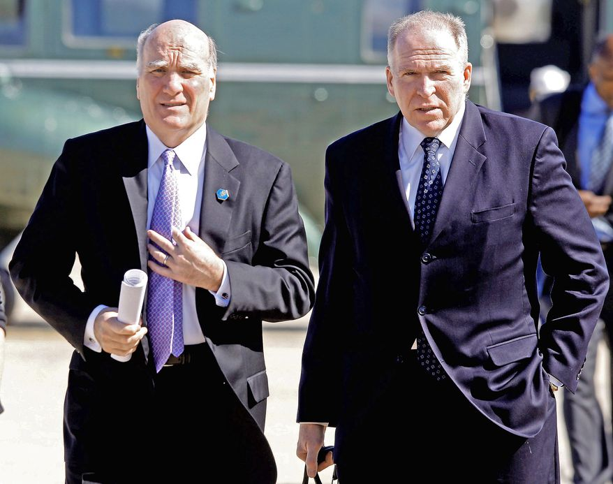 **FILE** Homeland Security Adviser John Brennan (right) and White House Chief of Staff Bill Daley accompany President Obama at Andrews Air Force Base, Md., on May 5, 2011, en route to New York City to visit ground zero and meet with first responders and family members of victims of the Sept. 11, 2001, attacks. (Associated Press)