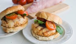 Chopped turkey tenderloin makes a lean and delicious burger, especially served with manchego. (Associated Press)