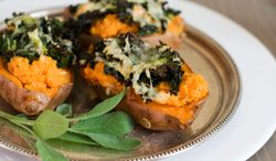 Loaded baked sweet potatoes make a savory one-bowl meal, especially in winter. (Associated Press)