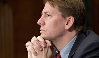 """Richard Cordray, director of the Consumer Financial Protection Bureau, announced """"the true essence of responsible lending."""" (Associated Press)"""