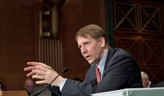 Consumer Financial Protection Bureau Director Richard Cordray said an effort was made to hit a balance between the abuses that once made mortgages too easy to get and overly strict standards that hampered borrowers with good credit. (Associated Press)