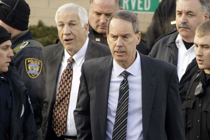 ** FILE ** In this Dec. 13, 2011, file photo, former Penn State University assistant football coach Jerry Sandusky, center left, walks with his attorney Joe Amendola, center right, as he leaves the Centre County Courthouse in Bellefonte, Pa. Sandusky is expected to appear on Thursday, Jan., 10, 2013, inside a central Pennsylvania courtroom for a hearing about whether his lawyers had enough time to prepare for trial. (AP Photo/Gene J. Puskar, File)