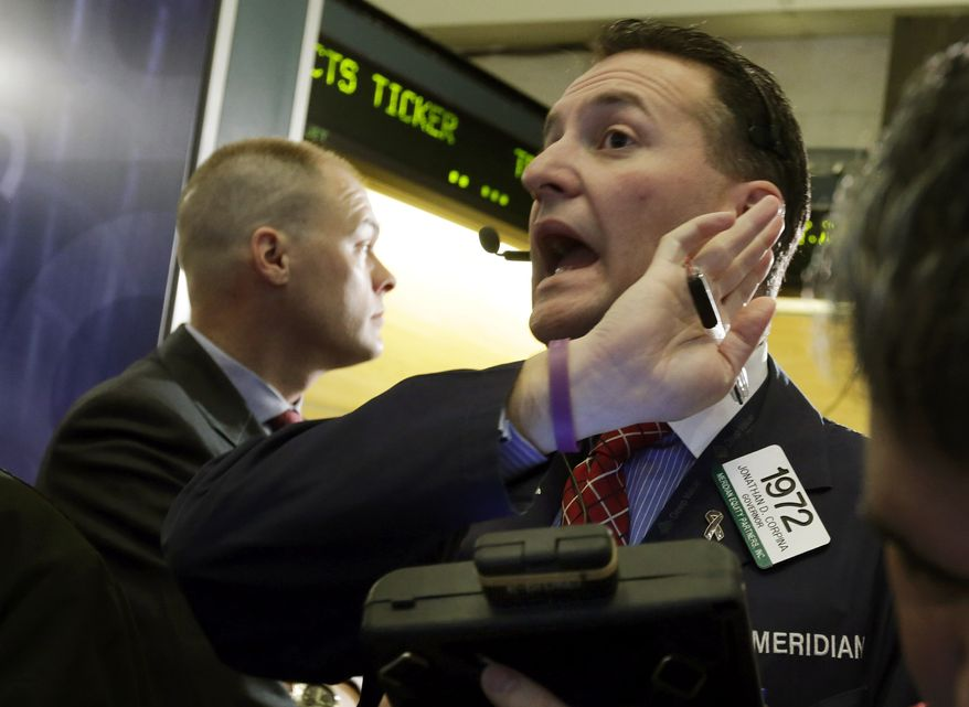 Trader Jonathan Corpina (right) works on the floor of the New York Stock Exchange on Jan. 10, 2013. (Associated Press)