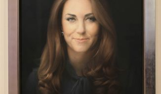 A newly-commissioned portrait of Kate, Duchess of Cambridge, by artist Paul Emsley hangs at the National Portrait Gallery in London on Jan. 11, 2013. (Associated Press)
