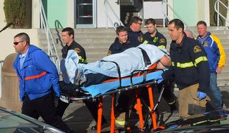 Paramedics transport a student wounded during a shooting on Jan. 10, 2013, at San Joaquin Valley High School in Taft, Calif. Authorities said a student was shot and wounded and another student was taken into custody. (Associated Press/Taft Midway Driller, Doug Keeler)
